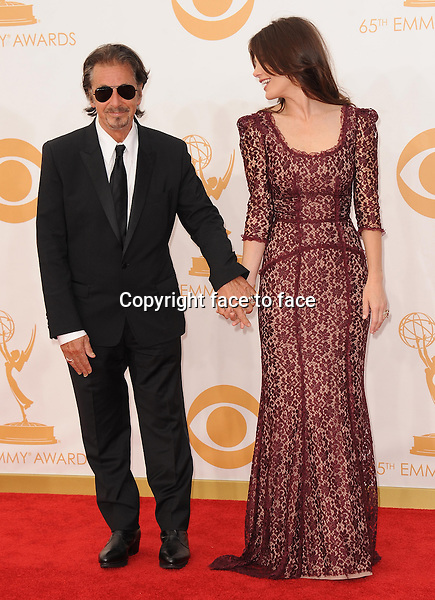 Al Pacino and Lucila Sola arrive at the 65th Primetime Emmy Awards at Nokia Theatre on Sunday Sept. 22, 2013, in Los Angeles.<br />