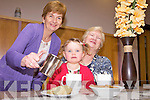 CUPPA TIME: Bridie Mulvihill of the Listowel Family Resource Centre serves up the tea at the launch of the new monthly Grandparents Tea Party, pictured here with Niamh Shanahan and her grandmother Mary Anne O'Connor.