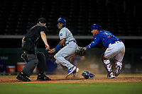AZL Royals Herard Gonzalez (2) looks to home plate umpire Austin Nelson after sliding under the tag of catcher Henderson Perez (8) during an Arizona League game against the AZL Cubs 1 on June 30, 2019 at Sloan Park in Mesa, Arizona. AZL Royals defeated the AZL Cubs 1 9-5. (Zachary Lucy/Four Seam Images)