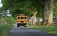 NWA Democrat-Gazette/DAVID GOTTSCHALK A Farmington Public Schools bus drives Tuesday, May 7, 2019, on Gibson Hill Road from the intersection of Wesley Stevens Road. Washington County is working with local school districts to identify and improve some of the narrow, dangerous county roads that double as bus routes.