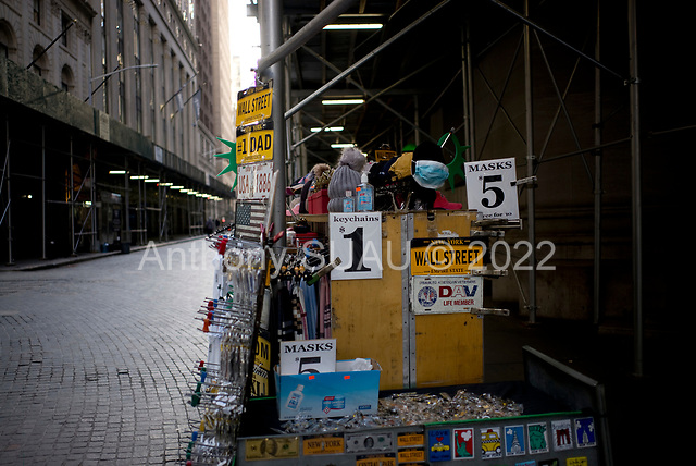 New York, New York<br /> March 18, 2020<br /> 8:47 AM<br /> <br /> Manhattan under coronavirus pandemic. <br /> <br /> The New York Stock Exchange and Wall Street void of people as the market falls over 10,000 points following weeks of the economic fear as a result of the virus. Face masks are sold near the exchange building.