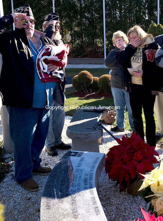 Watertown, CT- 01 November 2015-112915CM02-  Auxiliary Members of the Oakville VFW Post 7330, including Marty Murphy, left, salute during an unveiling of a memorial bench at Veteran's Memorial Park in Watertown on Sunday morning.  Reacting is Mary Ann Bunnell of Watertown, left, who stands beside Kathy Moher, mother of U.S Army Captain Anthony Fusco.  The bench was erected to remember three local veterans who served with the U.S. Army.  The three men included Captain Anthony Fusco, Private First Class Gebrah Noonan and Sergeant First Class Dae Han Park.  Approximately 30 people attended the ceremony.       Christopher Massa Republican-American