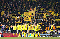 Borussia Dortmund players celebrate victory over Tottenham Hotspur in front of their fans after the UEFA Europa League match between Tottenham Hotspur and Borussia Dortmund at White Hart Lane, London, England on 17 March 2016. Photo by David Horn / PRiME Media Images