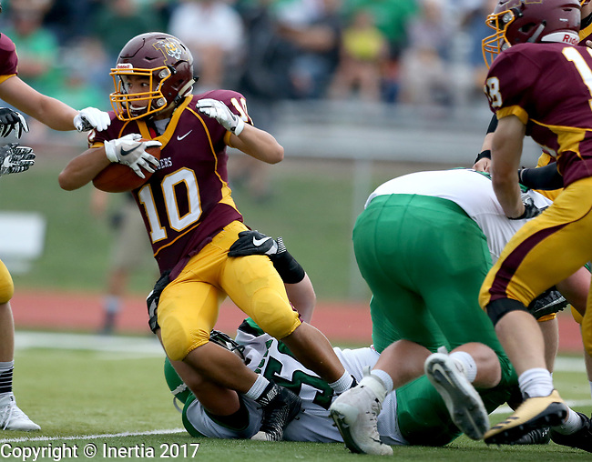 HARRISBURG, SD - AUGUST 25: Pierre's Mike Lusk #5 drags down Harrisburg's Jhei Roewart #10 in the first half of their game Friday night at Harrisburg. (Photo by Dave Eggen/Inertia)