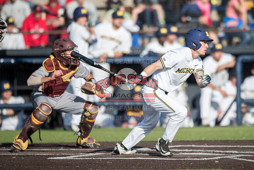 Michigan Wolverines designated hitter Nick Poirier (28) follows through on his swing against the Central Michigan Chippewas on May 9, 2017 at Ray Fisher Stadium in Ann Arbor, Michigan. Michigan defeated Central Michigan 4-2. (Andrew Woolley/Four Seam Images)