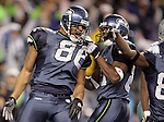 Seattle's Jerramy Stevens, left, celebrates with teammate Nate Burleson after scoring the winning touchdown in the fourth quarter against Dallas in an NFC Wild-Card game in Seattle on Saturday, January 6, 2007.  (Fort Worth Star-Telegram/Khampha Bouaphanh)
