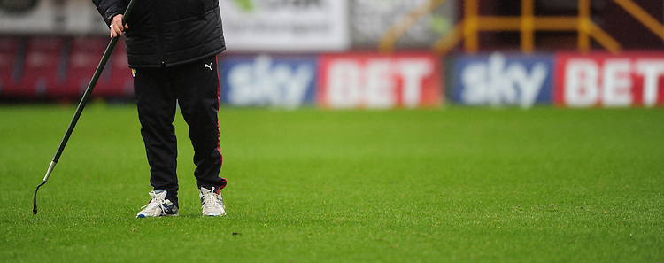A Burnley groundsman works on the Turf Moor pitch in front of a Sky Bet advertising board<br /> <br /> Photographer Chris Vaughan/CameraSport<br /> <br /> Football - The Football League Sky Bet Championship - Burnley v Hull City - Saturday 6th February 2016 - Turf Moor - Burnley <br /> <br /> &copy; CameraSport - 43 Linden Ave. Countesthorpe. Leicester. England. LE8 5PG - Tel: +44 (0) 116 277 4147 - admin@camerasport.com - www.camerasport.com
