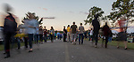 Guests at the 16th annual Pawpaw Festival walk by as the sun sets on Saturday. Photo by Katelyn Vancouver