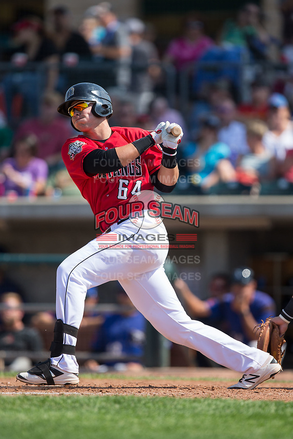 Pabel Manzanero (64) of the Billings Mustangs follows through on his swing against the Missoula Osprey at Dehler Park on August 20, 2017 in Billings, Montana.  The Osprey defeated the Mustangs 6-4.  (Brian Westerholt/Four Seam Images)