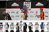 Alexander Rossi, Andretti Autosport Honda, Will Power, Team Penske Chevrolet, Scott Dixon, Chip Ganassi Racing Honda celebrate on the podium with champagne
