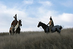 Two Native American Indian men sitting bareback on horses in traditional Sioux Indian clothing in South Dakota