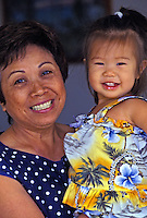Little asian girl and auntie smiling for the camera
