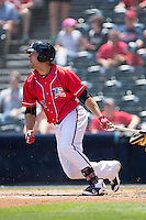 Mac Williamson (7) of the Richmond Flying Squirrels follows through on his swing against the Bowie Baysox at The Diamond on May 24, 2015 in Richmond, Virginia.  The Flying Squirrels defeated the Baysox 5-2.  (Brian Westerholt/Four Seam Images)