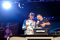 NWA Democrat-Gazette/BEN GOFF -- 04/25/15 Andy Morgan, FLW Pro from Dayton, Tenn., weighs-in with master of ceremonies Chris Jones on day three of the Walmart FLW Tour at Beaver Lake on Saturday Apr. 25, 2015 at the John Q. Hammons Center in Rogers. Morgan maintained his lead with a three-day total weight of 39 lbs. 2 oz.