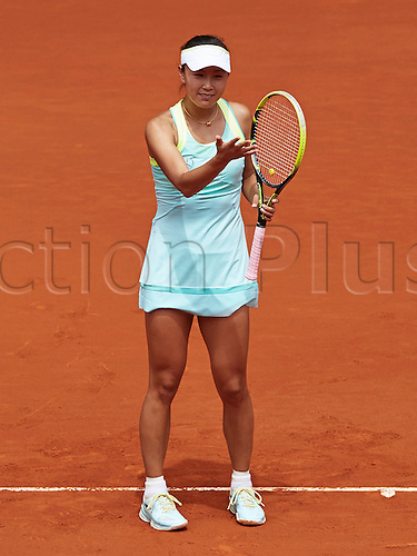 07.05.2014 Madrid, Spain. Shuai Peng of China questions a line call during the game with Serena Williams of USA on day 4 of the Madrid Open from La Caja Magica.