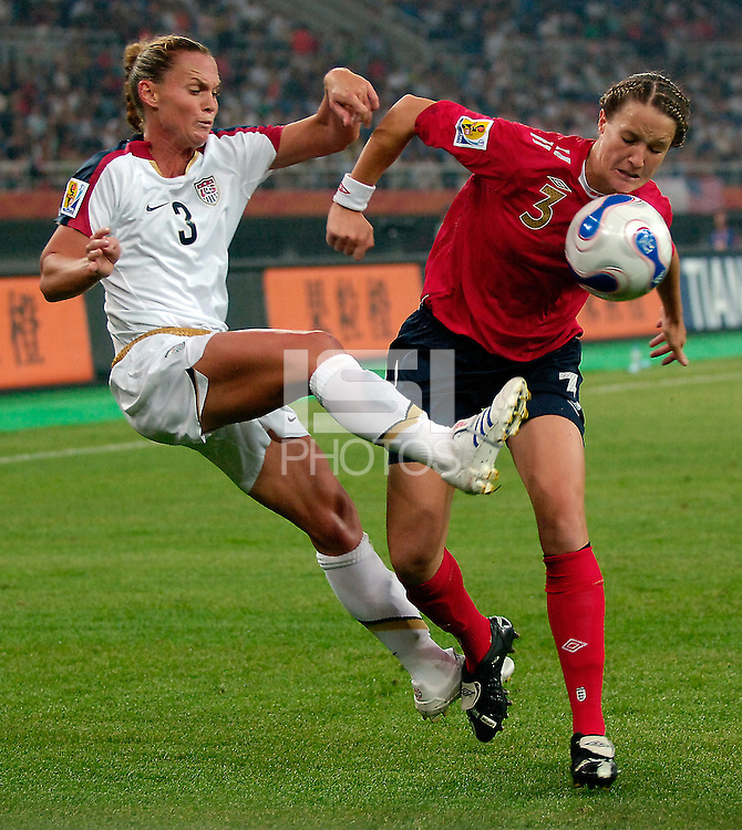 USA defender Christie Rampone (3) defends against England defender Casey Stoney (3, r). The United States (USA) defeated England (ENG) 3-0 during a quarter-final match of the FIFA Women's World Cup China 2007 at Tianjin Olympics Center Stadium in Tianjin, China, on September 22, 2007.