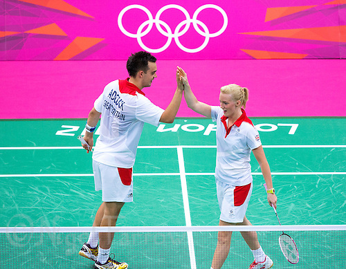 28 JUL 2012 - LONDON, GBR - Chris Adcock (GBR) and partner Imogen Bankier (GBR) of Great Britain celebrate a point during their London 2012 Olympic Games mixed doubles group badminton match against Alexandr Nikolaenko and Valeria Sorokina of Russia at Wembley Arena, London, Great Britain .(PHOTO (C) 2012 NIGEL FARROW)