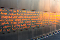 Twilight colors in the western sky illuminate the names on the New Jersey 9/11 Empty Sky Memorial.  The memorial, which honors the New Jersey residents lost in the events of September 11, 2001, is located in Liberty State Park in Jersey City, New Jersey.