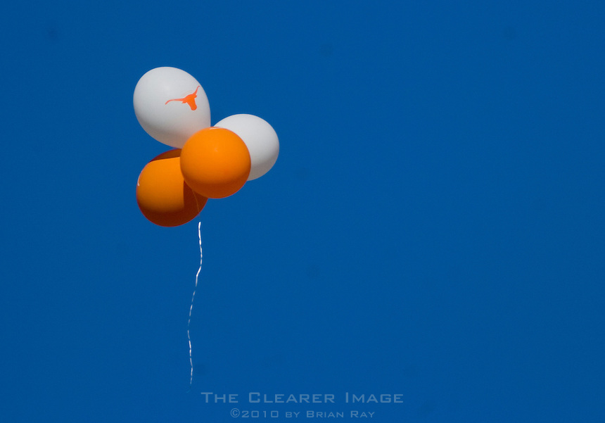 24 November 2006: A collection of Longhorn balloons float up into the sky following the Lonestar Showdown football game between the University of Texas Longhorns and the Texas A&M Aggies at Darrell K Royal Memorial Field in Austin, TX.