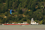 Kitesurfing in the Columbia River Gorge with barge, Hood River, Oregon
