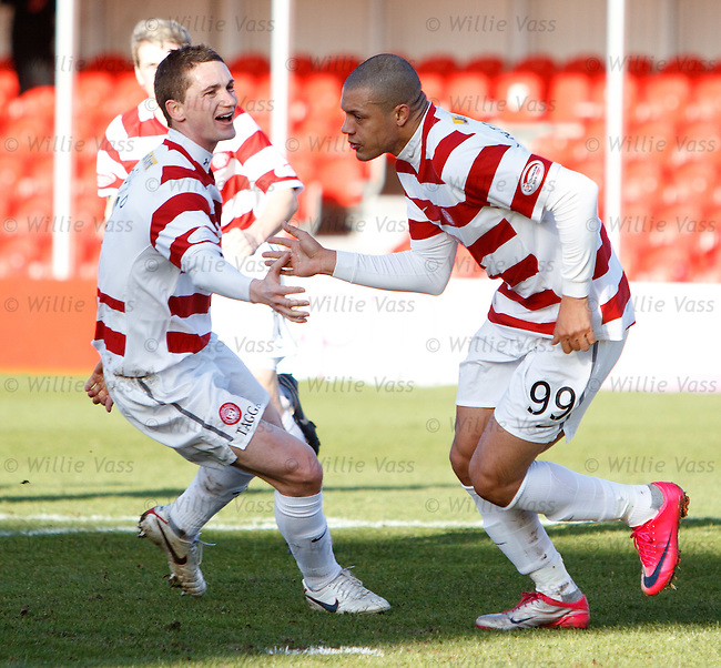 Mikael Antoine-Curier celebrates as he opens the scoring for Hamilton ffrom the penalty spot