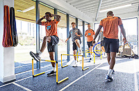 (C) Luciano Narsingh, Daniel James and Mike van der Hoorn exercise in the gym during the Swansea City Training Session at The Fairwood Training Ground, Swansea, Wales, UK. Thursday 27 September 2018
