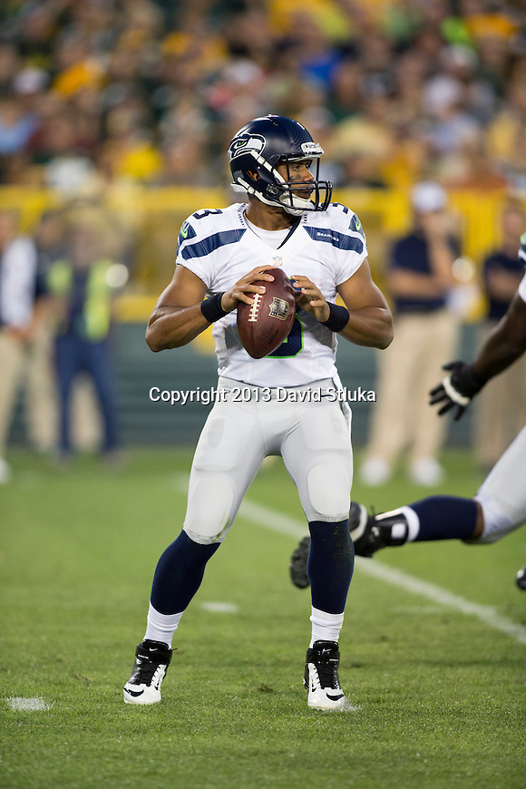 Seattle Seahawks quarterback Russell Wilson (3) drops back to pass during an NFL preseason week 3 football game against the Green Bay Packers Thursday, August 23, 2013, in Green Bay, Wis. The Seahawks won 17-10 . (Photo by David Stluka)