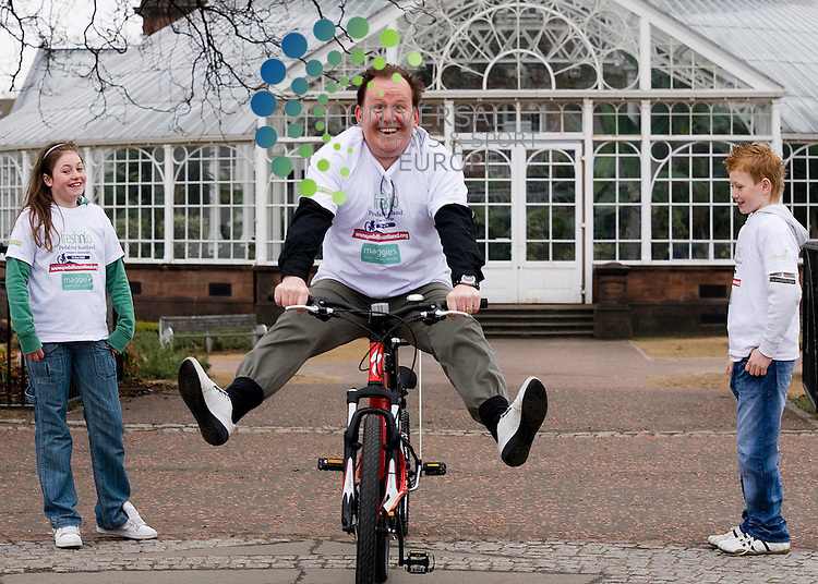 Ford Kiernan helps launch Pedal for Scotland bike ride with kids from milton primary , jodie weir age 10 and brother   age 9: The 12-year-old son of Scottish comedian and actor Ford Kiernan has been found dead at the family home in the west end of Glasgow. Police Scotland said they received a report of the child's death late on Monday night. Sonny was the younger of 51-year-old Mr Kiernan's two children and his death is currently being treated as unexplained. A post mortem examination will be carried out in due course to establish the exact cause of death.<br />