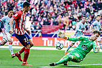 Goalkeeper Ruben Blanco Veiga of RC Celta de Vigo (R) reaches for the ball after an attempt at goal by Victor Machin, Vitolo, of Atletico de Madrid (L) during the La Liga 2017-18 match between Atletico de Madrid and RC Celta de Vigo at Wanda Metropolitano on March 11 2018 in Madrid, Spain. Photo by Diego Souto / Power Sport Images