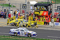 Joey Logano, (#20) makes a pit stop.
