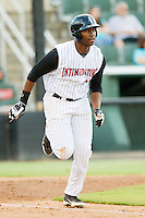 Kannapolis Intimidators first baseman Keon Barnum (35) hustles down the first base line against the Greensboro Grasshoppers at CMC-Northeast Stadium on July 12, 2013 in Kannapolis, North Carolina.  The Grasshoppers defeated the Intimidators 2-1.   (Brian Westerholt/Four Seam Images)