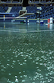 US Open 2000, New York, USA. Arthur Ashe Stadium during rain delay with water on court and rain falling.