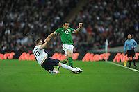 29.05.2013 London, England. Stephen Kelly, Republic of Ireland, is tackled by Phil Jones, England, during the International Friendly between England and Republic of Ireland from Wembley Stadium.