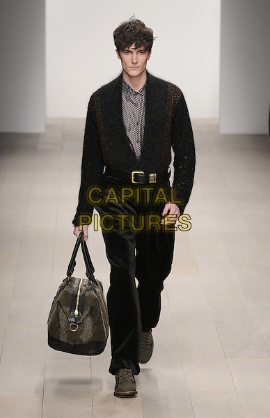 model catwalkingy.The James Long a/w 2012 catwalk show, London Fashion Week, Menswear Day, BFC Show Space, Somerset House, The Strand, London, England..February 22nd, 2012.LFW runway full length black trousers jacket bag.CAP/CAN.©Can Nguyen/Capital Pictures.