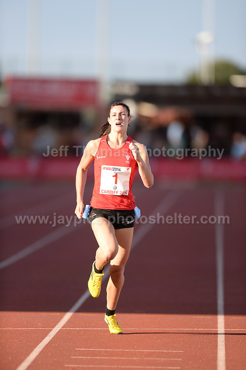International athletics at Cardiff International stadium, Cardiff, South Wales - Tuesday 15th July 2014<br /> <br /> Seren Bundy-Davies of Wales winning the Women's 400m final. <br /> <br /> <br /> Photo by Jeff Thomas Photography