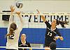 Massapequa No. 13 Mackenzie Byrne, right, makes a spike attempt during a Nassau County varsity girls' volleyball match against host Plainview JFK High School on Monday, October 19, 2015. Massapequa won 25-16, 25-8, 25-13.<br /> <br /> James Escher