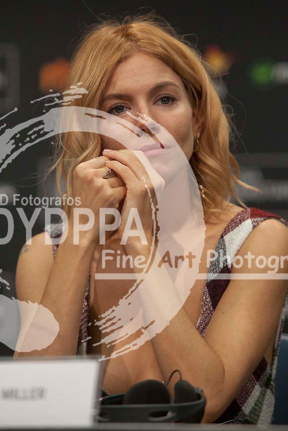 Sienna Miller poses