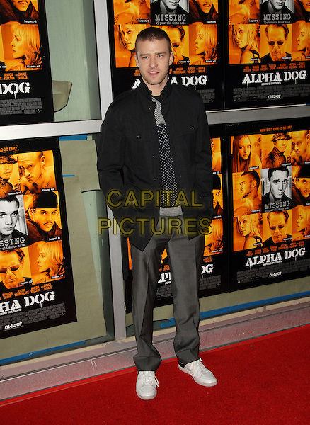 "JUSTIN TIMBERLAKE.Universal Pictures World Premiere of ""Alpha Dog"" held at The Arclight Theatre in Hollywood, California, USA. .January 3rd, 2007.full length black jacket grey gray trousers white sneakers trainers.CAP/DVS.©Debbie VanStory/Capital Pictures"