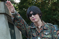 A man dressed in Germn WW2 ear army uniforms gives a nazi salute during the 70th anniversary celebrations of the end of the Pacific war  at the controversial Yasukuni Shrine in Kudanshita, Tokyo, Japan Saturday August 15th 2015