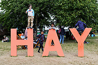 Pictured: Children play on the HAY letters on the festival green. Friday 31 May 2019<br /> Re: Hay Festival, Hay on Wye, Wales, UK.