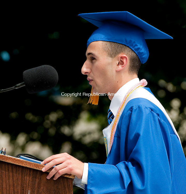 WOODBURY, CT-062114JS07--Nonnewaug High School Valedictorian Vincent Pistritto gives his address during graduation ceremonies Saturday at the school in Woodbury.<br /> Jim Shannon Republican-American