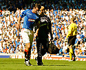 21/08/2005         Copyright Pic : James Stewart.File Name : jspa38 rangers v celtic.BARRY FERGUSON LIMPS OFF AFTER RECEIVING AN INJURY DURING A CHALLENGE BY BOBO BALDE WHICH HAS ALL BUT RULED HIM OUT OF THE CHAMPIONS LEAGUE QUALIFIER AGAINST FAMAGUSTA.... .Payments to :.James Stewart Photo Agency 19 Carronlea Drive, Falkirk. FK2 8DN      Vat Reg No. 607 6932 25.Office     : +44 (0)1324 570906     .Mobile   : +44 (0)7721 416997.Fax         : +44 (0)1324 570906.E-mail  :  jim@jspa.co.uk.If you require further information then contact Jim Stewart on any of the numbers above.........