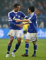 FUSSBALL   1. BUNDESLIGA   SAISON 2012/2013    25. SPIELTAG FC Schalke 04 - Borussia Dortmund                         09.03.2013 Schalker Schlussjubel: Joel Matip (li) und Atsuto Uchida (re, beide FC Schalke 04)