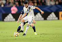 CARSON, CA - SEPTEMBER 21: Joe Corona #14 of the Los Angeles Galaxy moves with the ball during a game between Montreal Impact and Los Angeles Galaxy at Dignity Health Sports Park on September 21, 2019 in Carson, California.