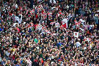 Japan supporters in the crowd celebrate at the final whistle, as South Africa fans look dejected. Rugby World Cup Pool B match between South Africa and Japan on September 19, 2015 at the Brighton Community Stadium in Brighton, England. Photo by: Patrick Khachfe / Stewart Communications