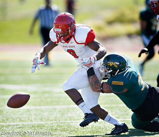 SPEARFISH, SD - SEPTEMBER 17: DeJon Coleman #9 of Dixie State has the ball stripped by a Black HIlls State defender during their college football game Saturday September 17, 2016 at Lyle Hare Stadium in Spearfish, S.D.   (Photo by Dick Carlson/Inertia)