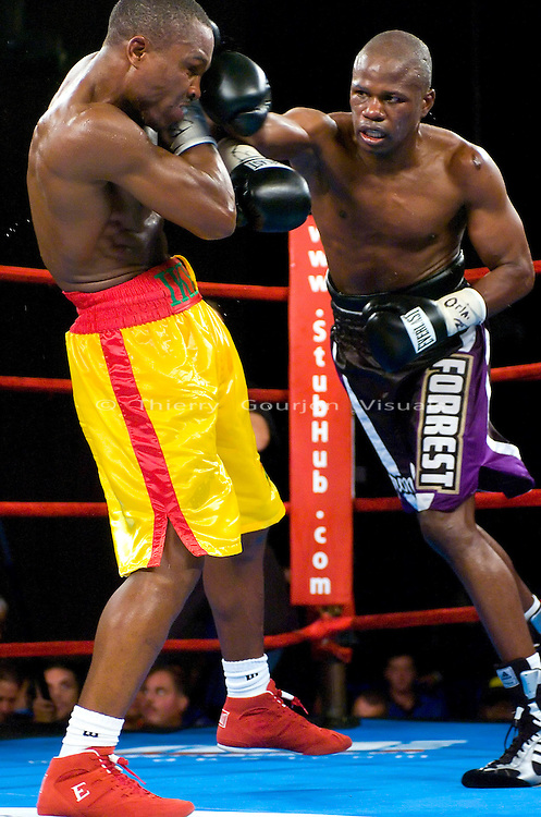 "Vernon Forest  (r)  on the attack against Ike ""Bazooka"" Quartey during their 10 rounds Junior Middleweight Fight at MSG in New York City on 08.05.06. Forest won by Unanimous Decision."