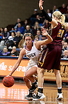 SIOUX FALLS, SD - FEBRUARY 28:  Madi Robson #10 from the University of Sioux Falls tries to get a stop past Katrina Nordick #21 from Minnesota Crookston during their NSIC Tournament Sunday at the Sanford Pentagon. (Photo by Dave Eggen/Inertia)