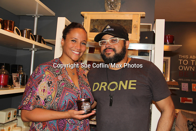 Guiding Light's Yvonna Kopacz Wright and husband Brett Wright as owners of Lomar Farms in Palisades, New York where they are beekeepers as they make beeswax candles and other products. Tonight May 4, 2018 they presented them at NiLu - gifts - lifestyle - home in Harlem where attendees viewed them, chatted, bought them. For more information go to www.lomarfarms.com. (Photo by Sue Coflin/Max Photo)