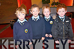 The pupils of Loughittane National  School enjoying the band of the first Southern Brigade Collins Barracks Cork at Muckross Church  last Thursday..L-Brian O'Connor, Nathan O'Connor, Darragh Horgan and Brian  Doody.
